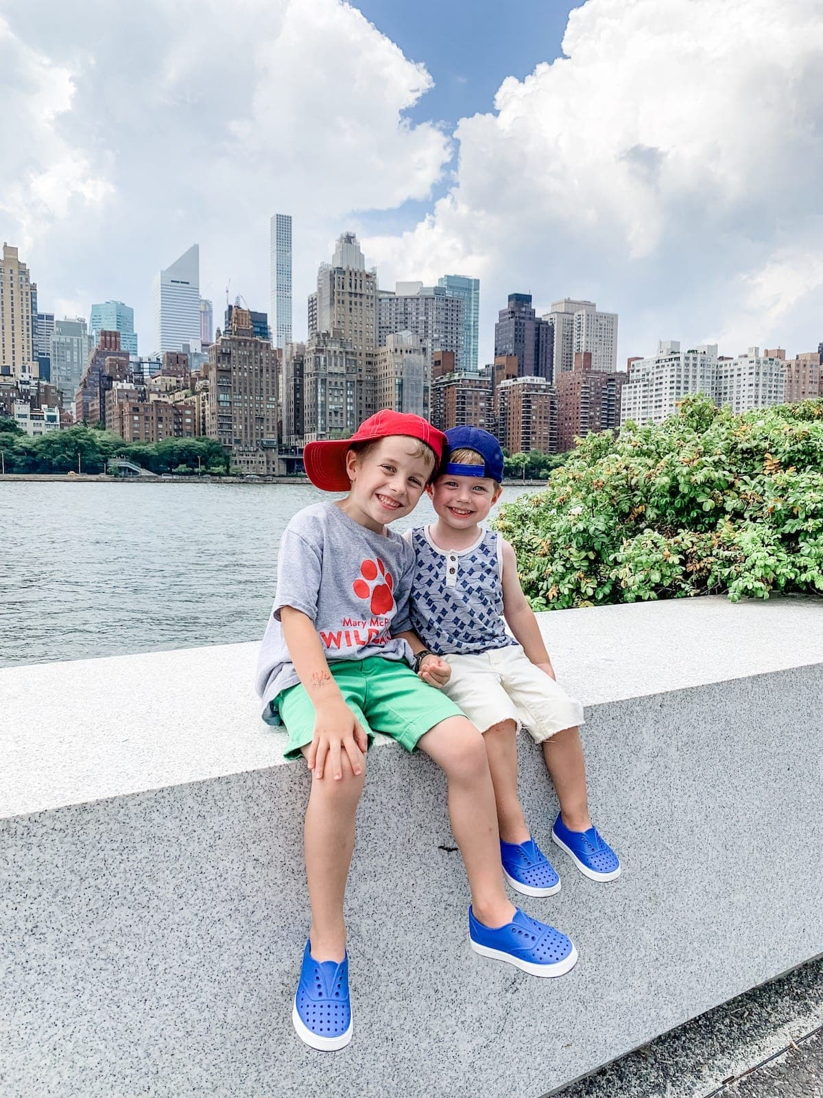 Blake and Eddie sitting with the city skyline behind them