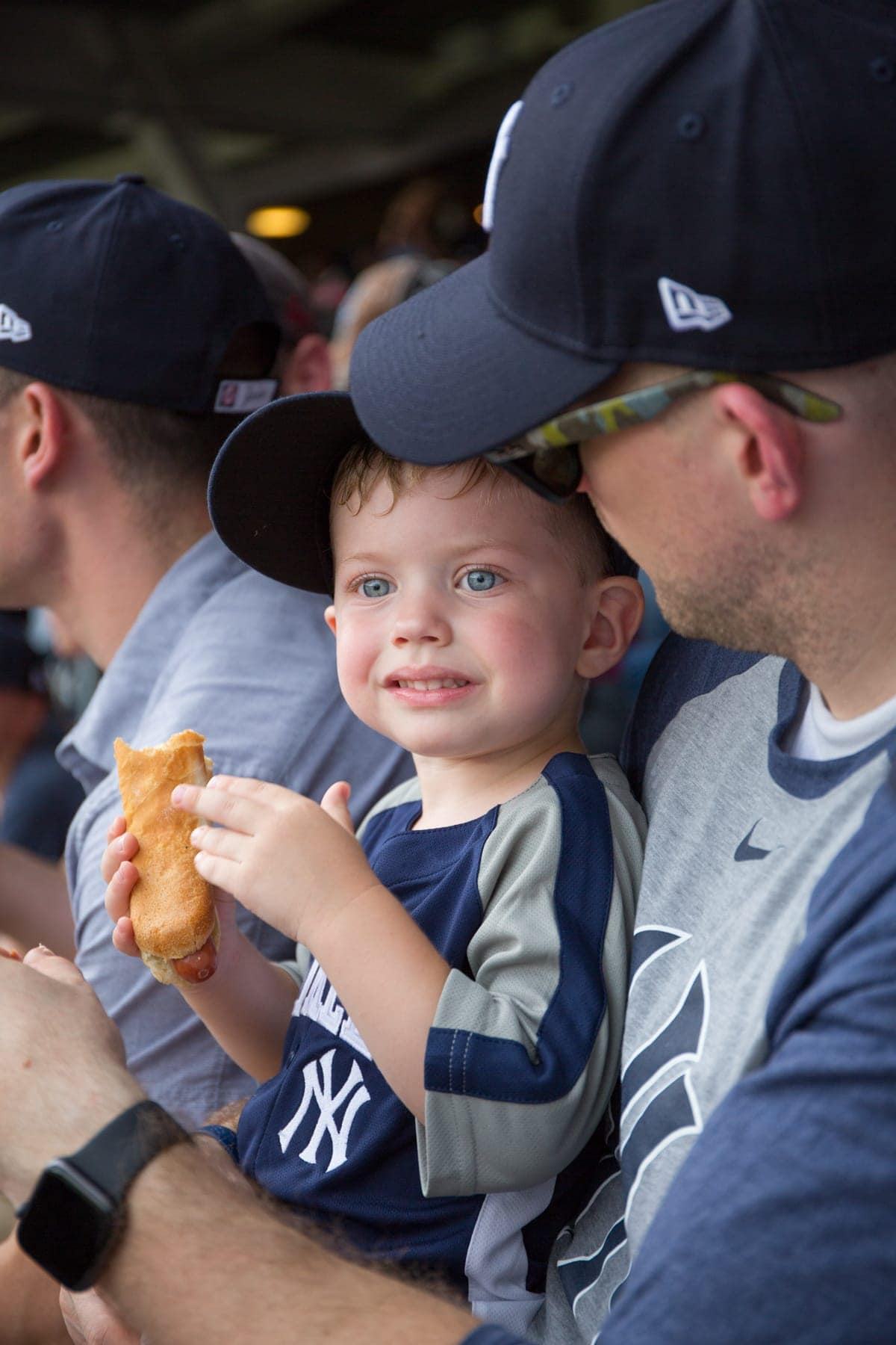 A young boy eating a hot dog
