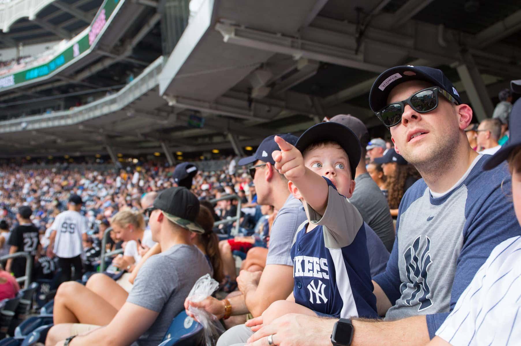 Eddie pointing to something at a baseball game