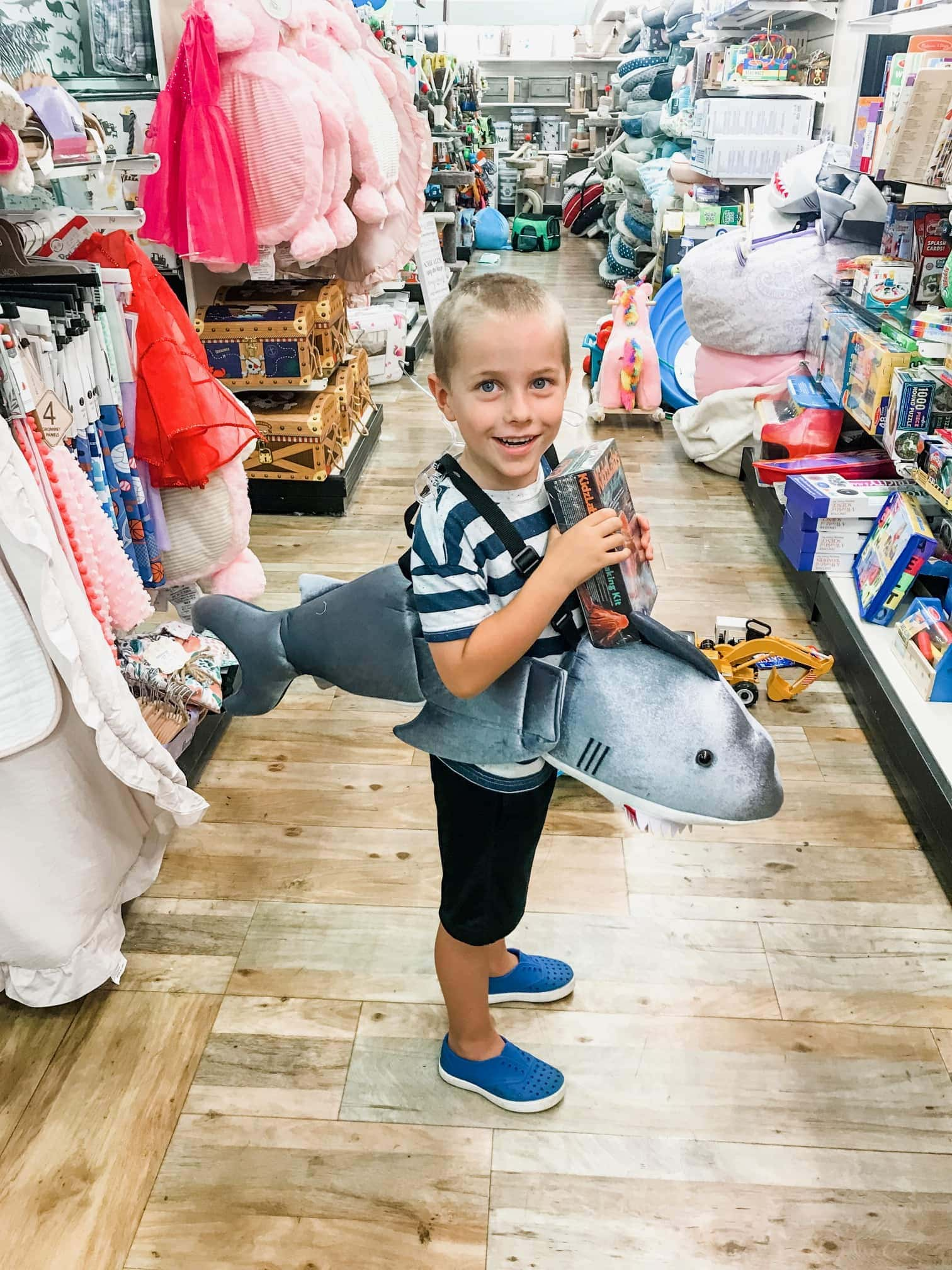Blake dressed as a shark in a store