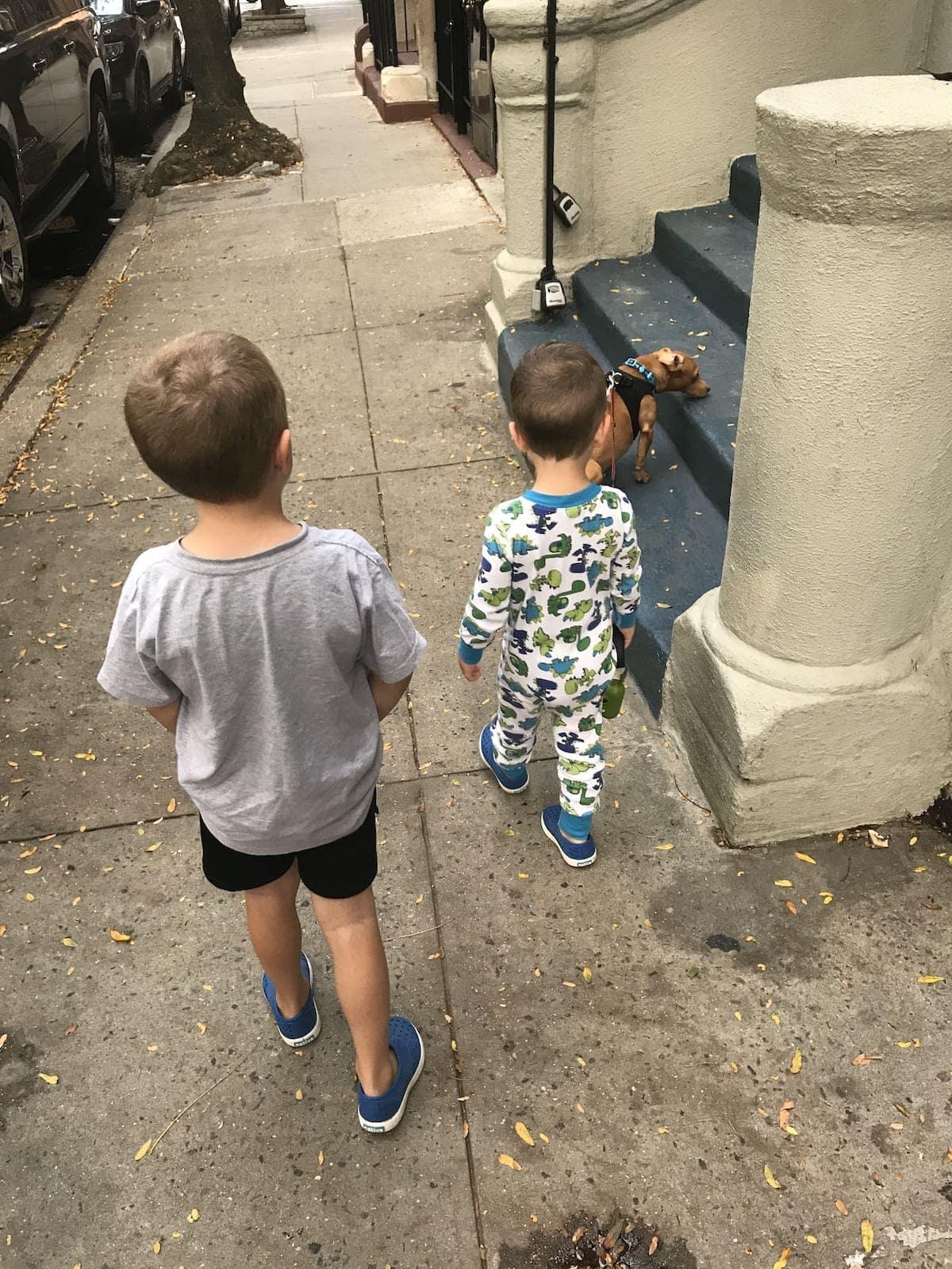 Blake and Eddie walking a dog
