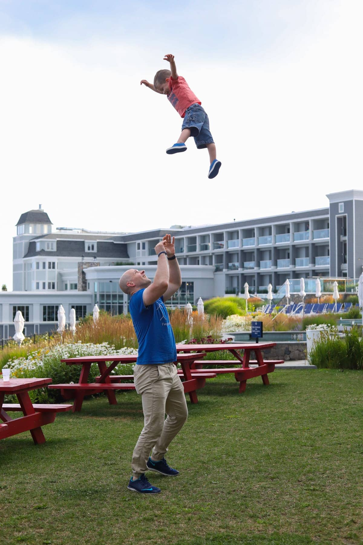 Gordon throwing Eddie up in the air