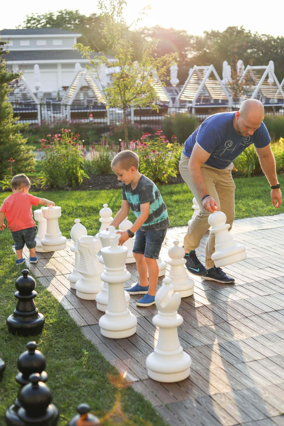 Gordon and the kids playing with the giant chess set