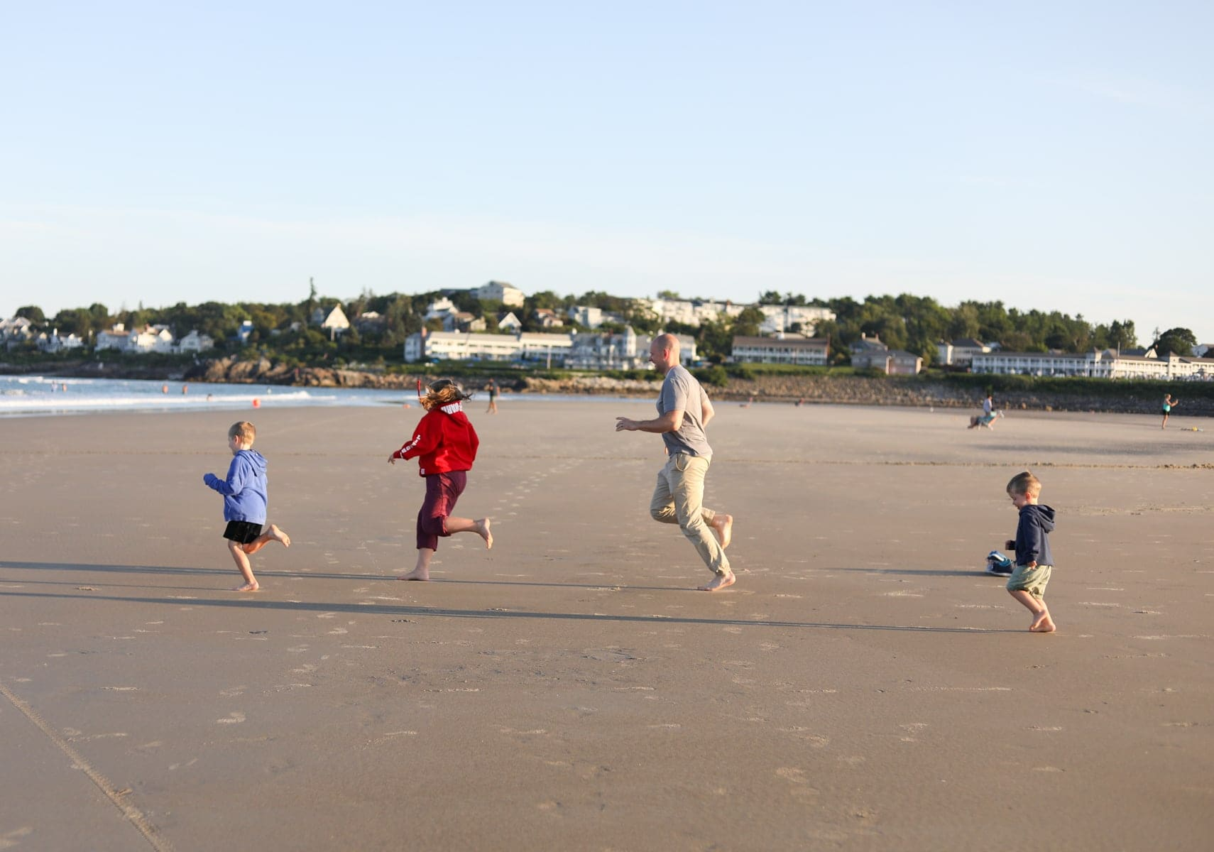 Gordon and the kids running at the beach