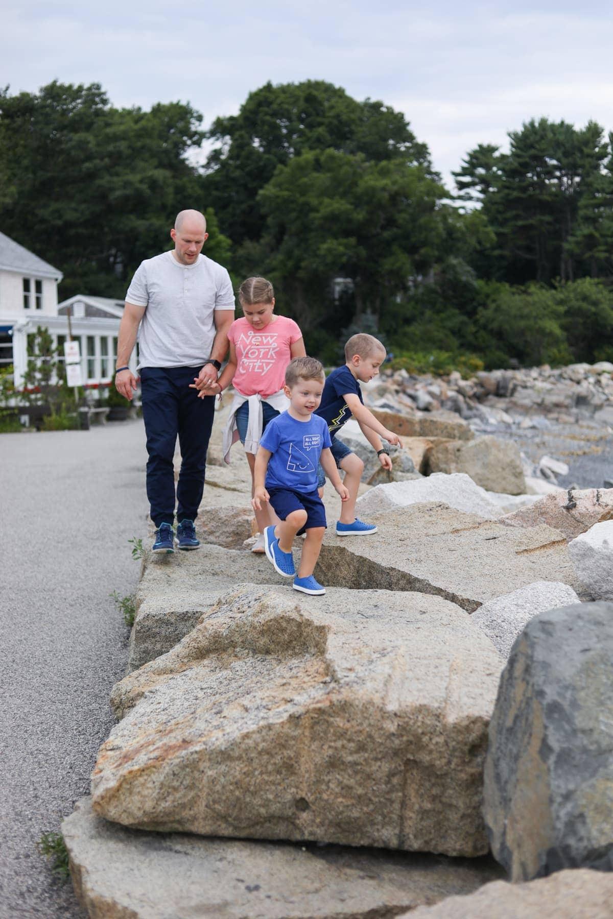 Gordon and the kids climbing on rocks