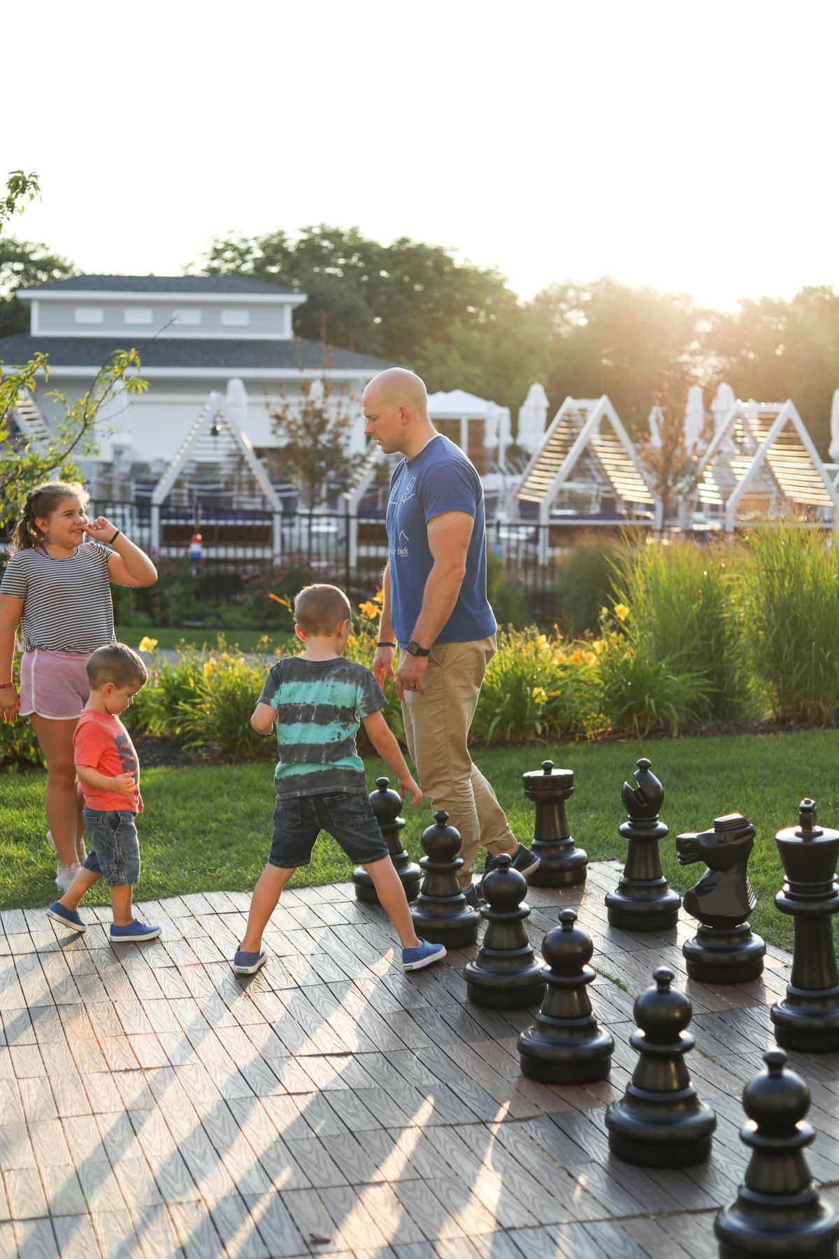 Gordon and the kids with a giant chess set