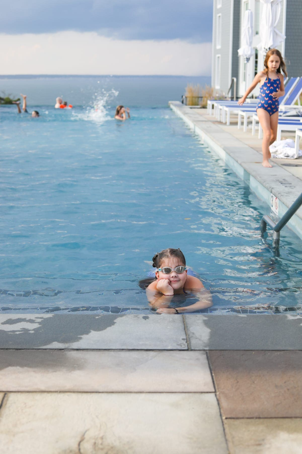 A child swimming in a pool of water