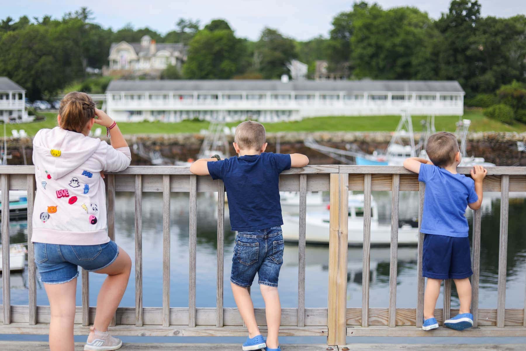 The kids looking at the water from a dock