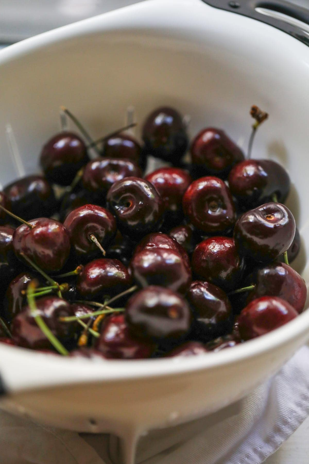 A close up of a bowl of cherries