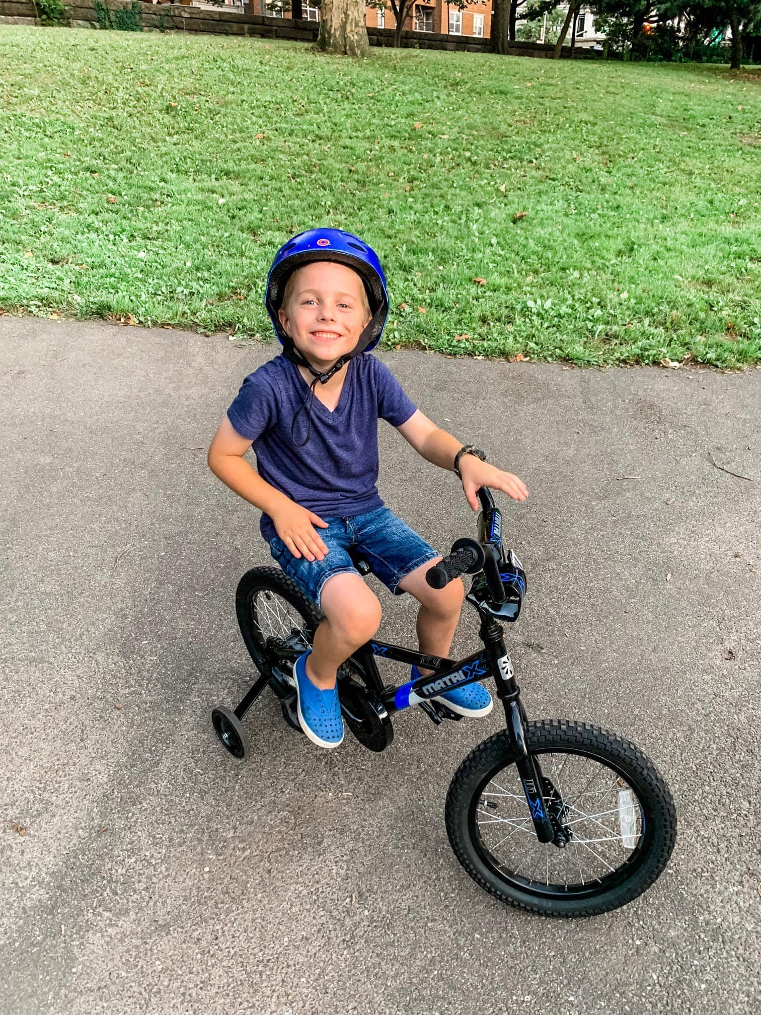 Blake wearing a helmet and riding a bicycle