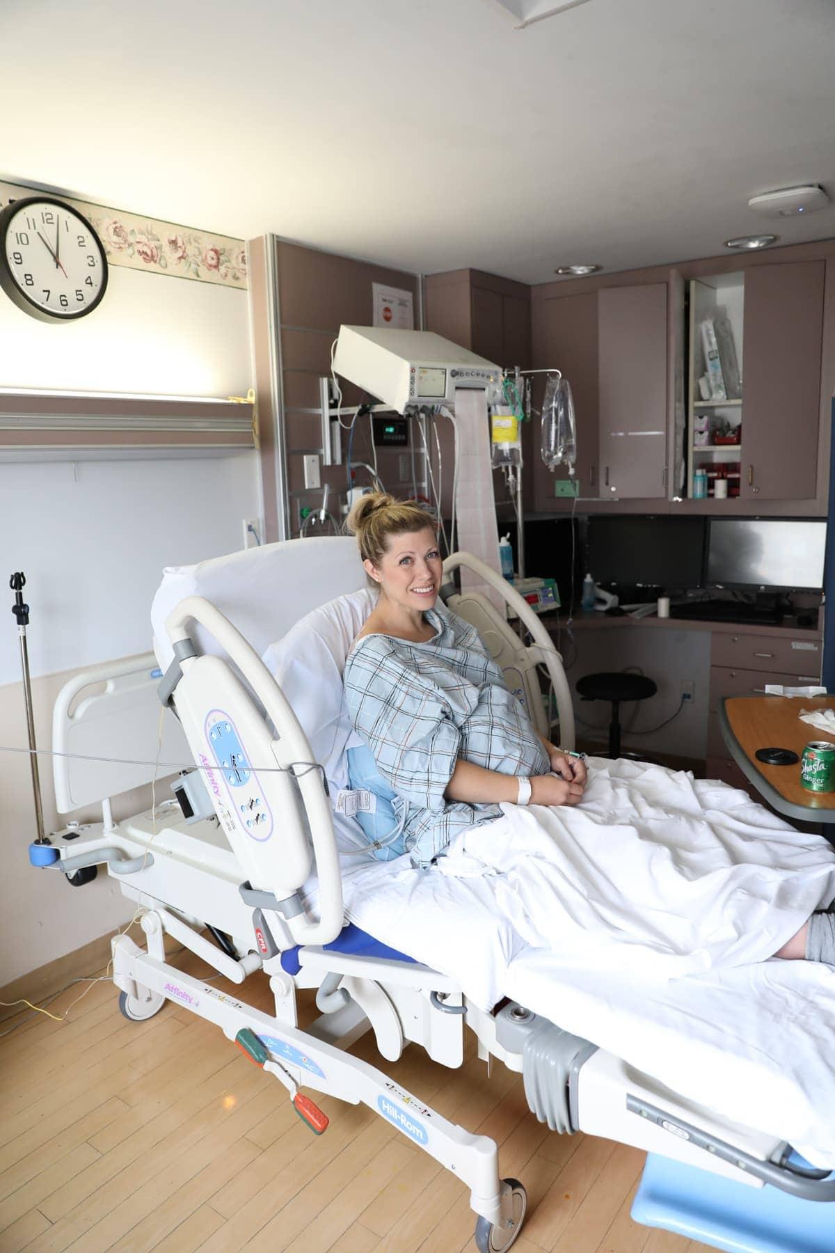 Lauren in a hospital bed
