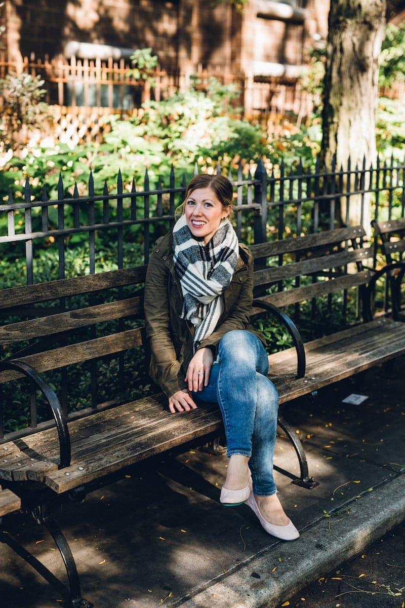 Lauren sitting on a park bench