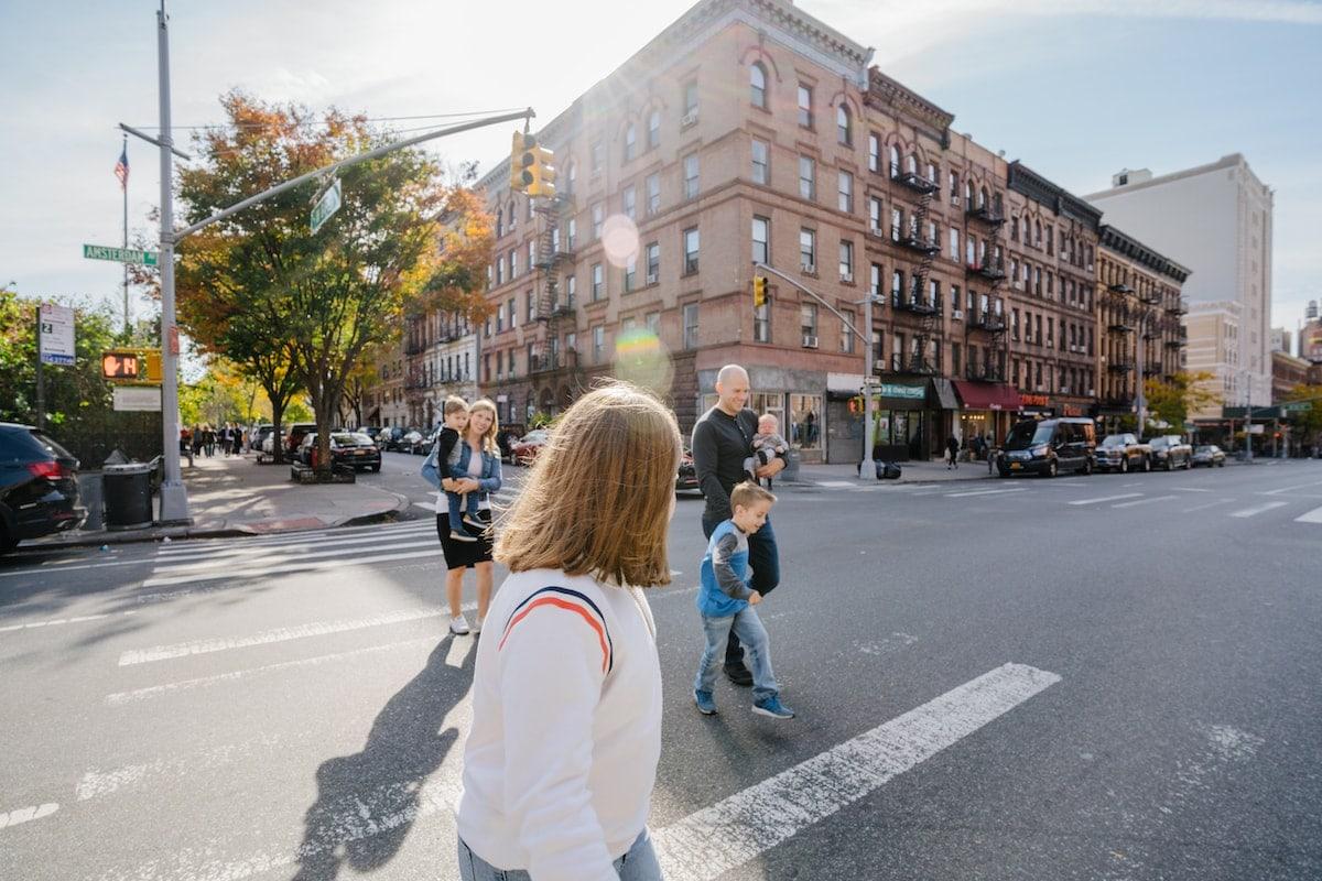 Family walking down a city street