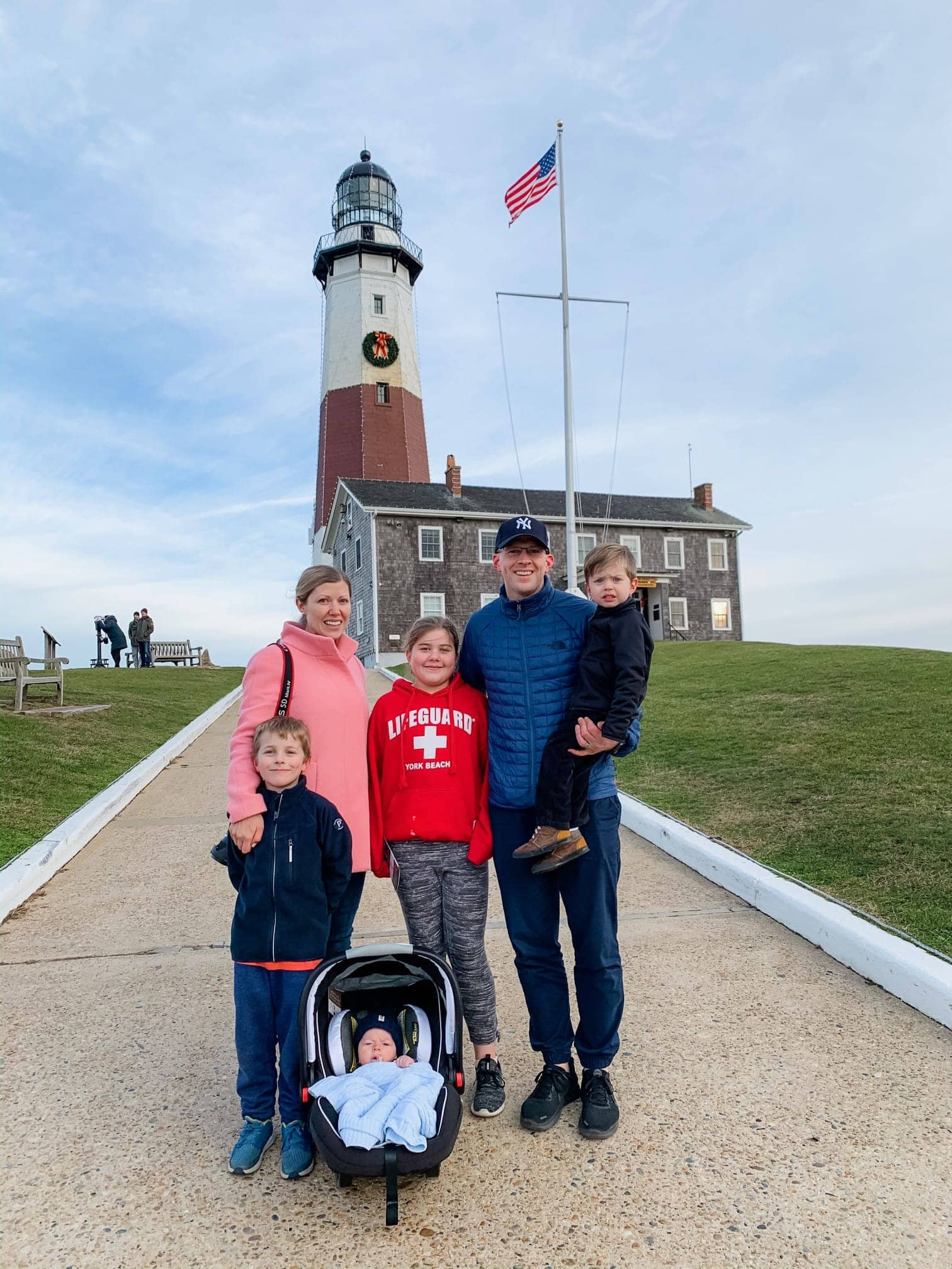 Brennan family in front of a lighthouse