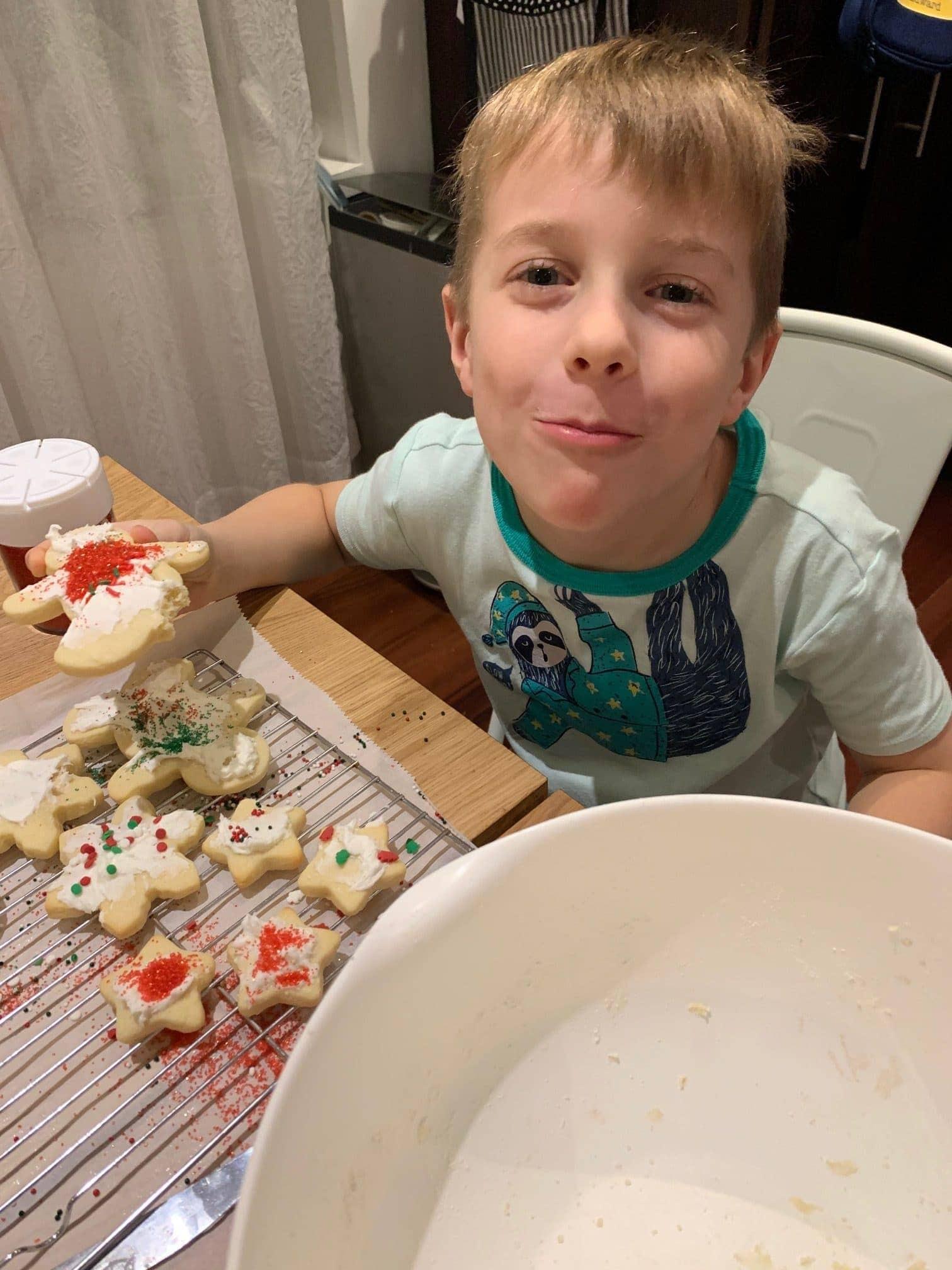 Blake eating a decorated sugar cookie