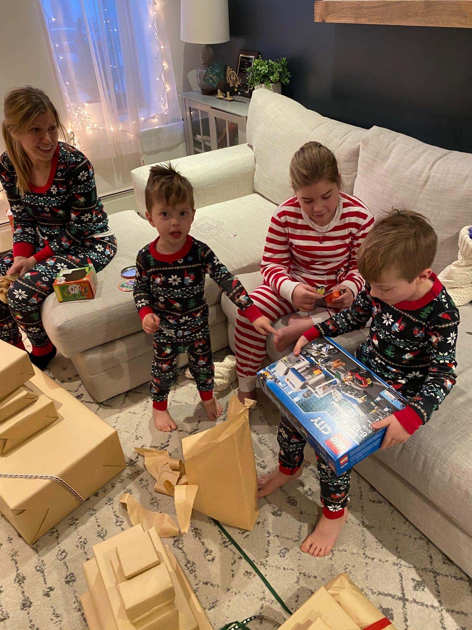 Blake opening a Christmas present surrounded by family