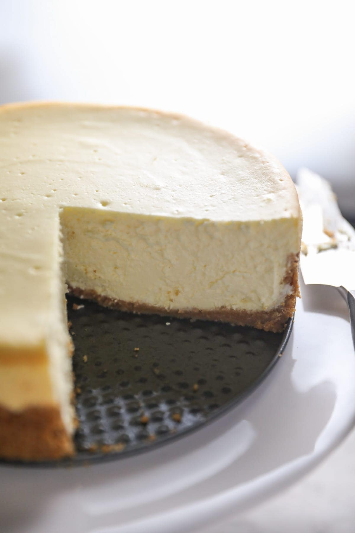 whole cheesecake with pieces removed