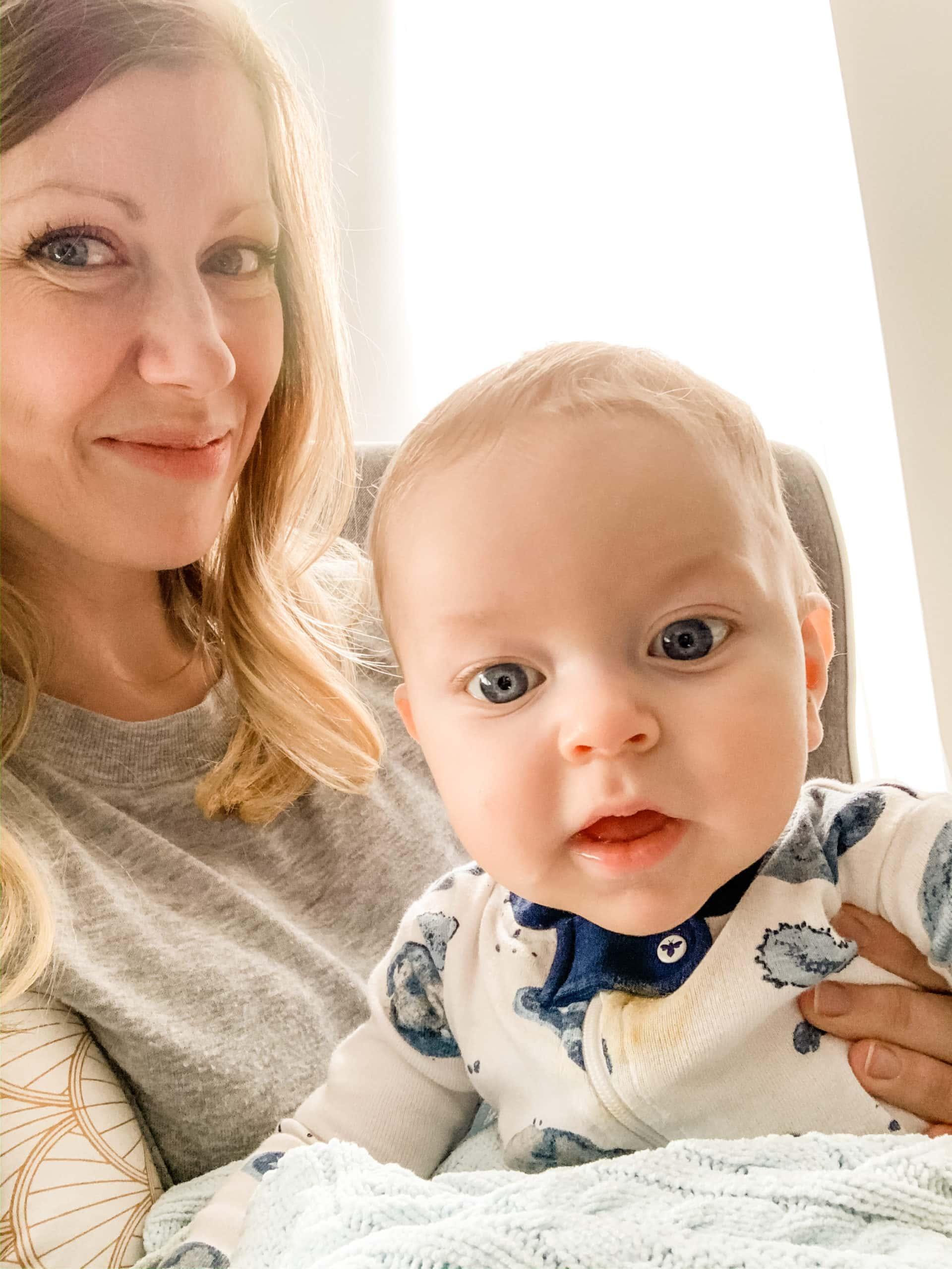 Lauren holding Porter posing for the camera