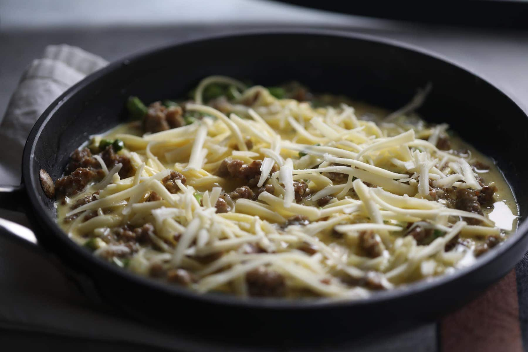 grated cheese on top of mixture