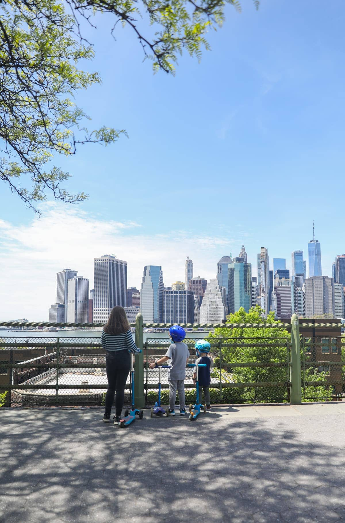kids with nyc skyline