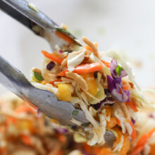 chinese asian slaw toss with tongs