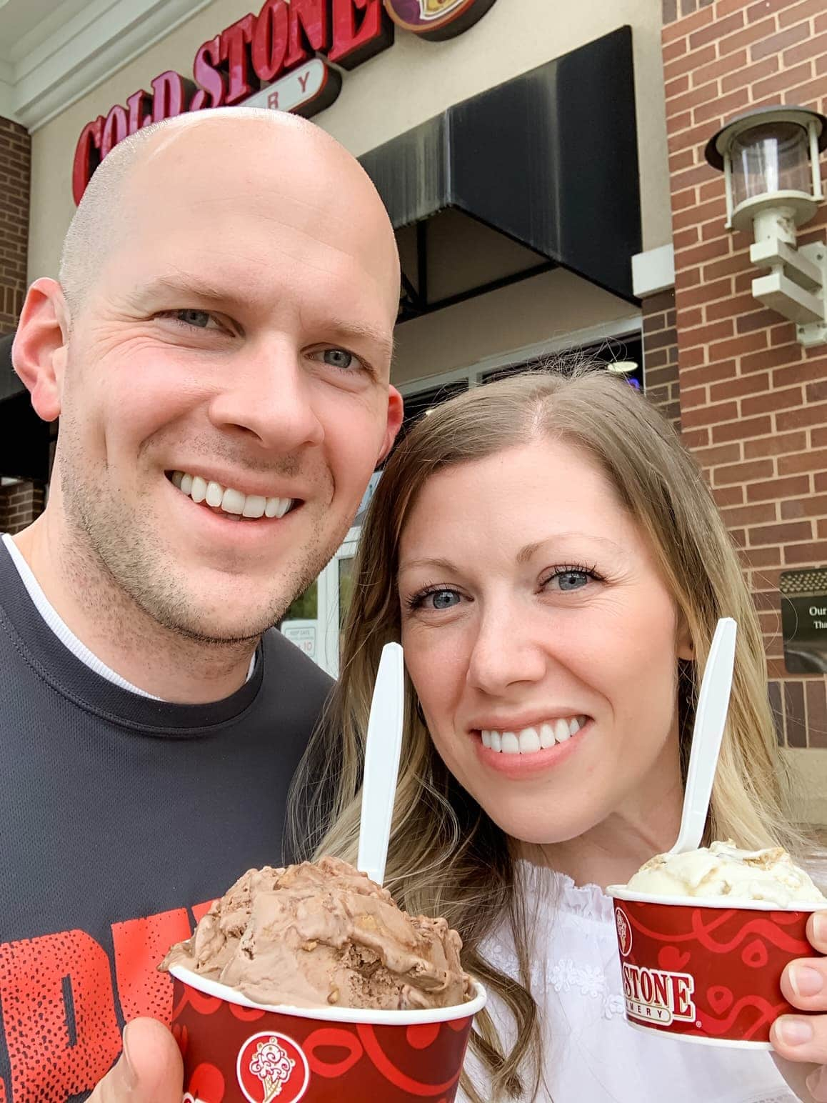husband and wife holding ice cream