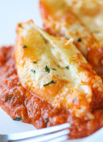 close up stuffed shells with sauce