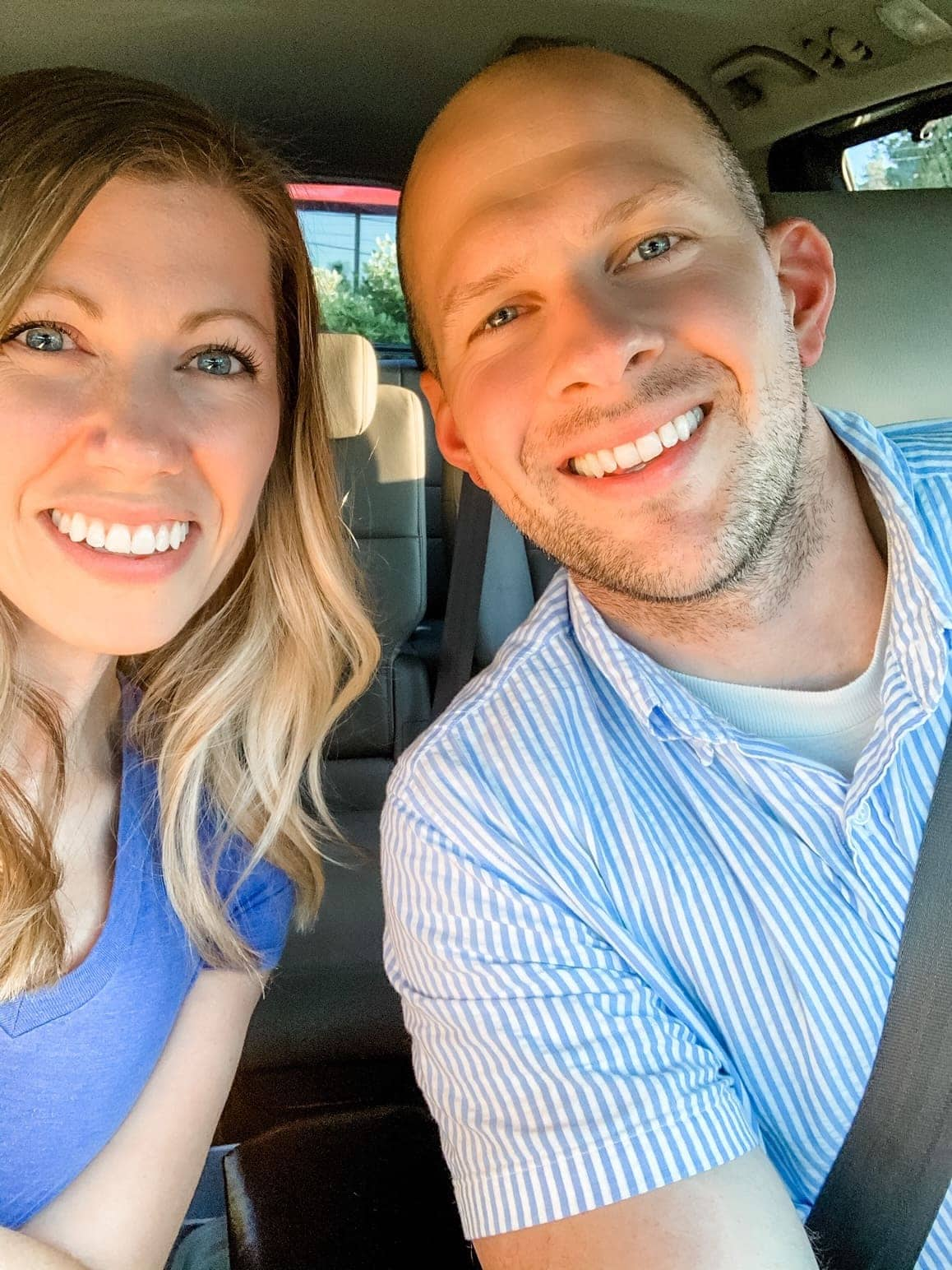husband and wife selfie in a car