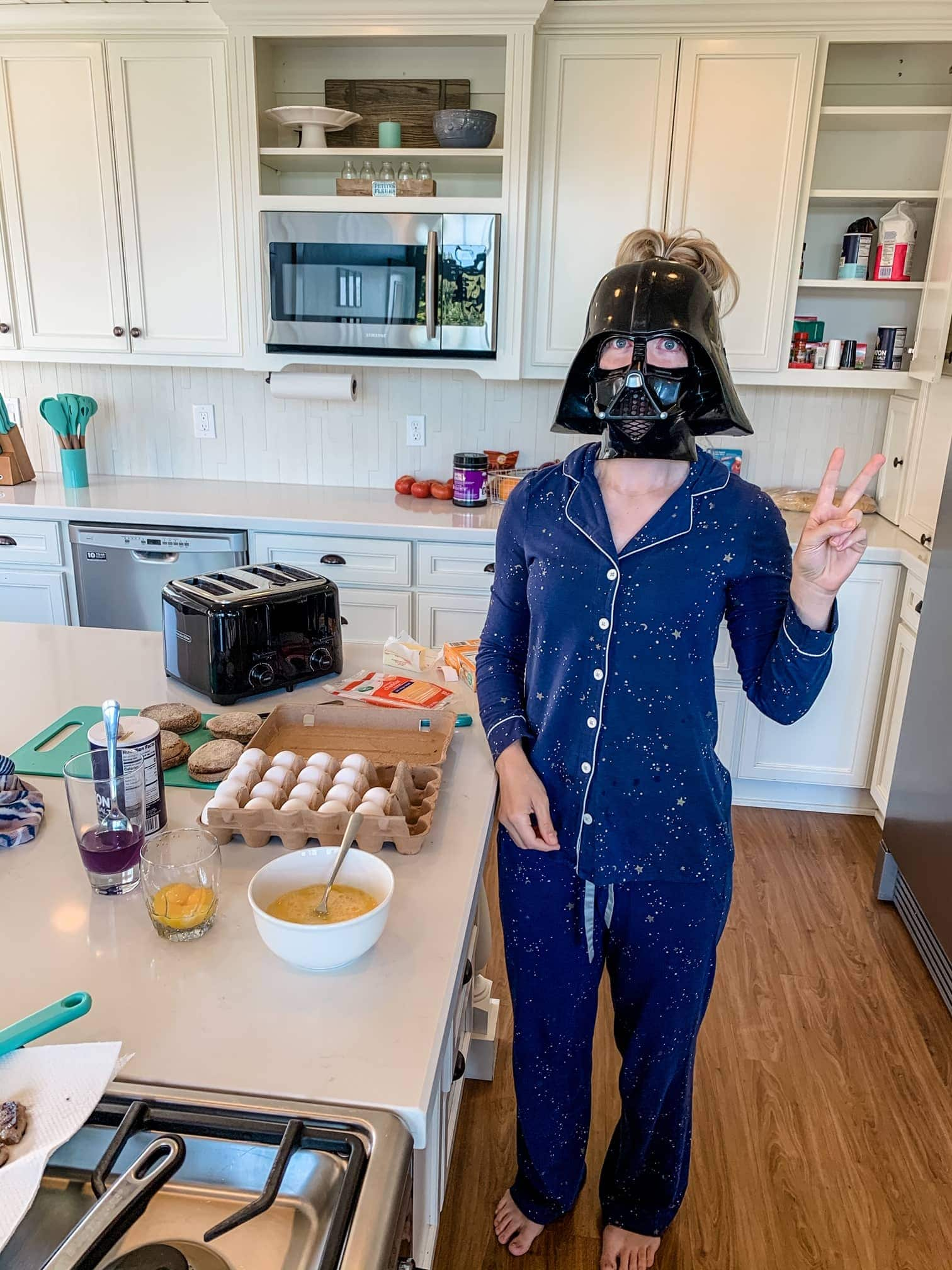 mom cooking breakfast with star wars mask on