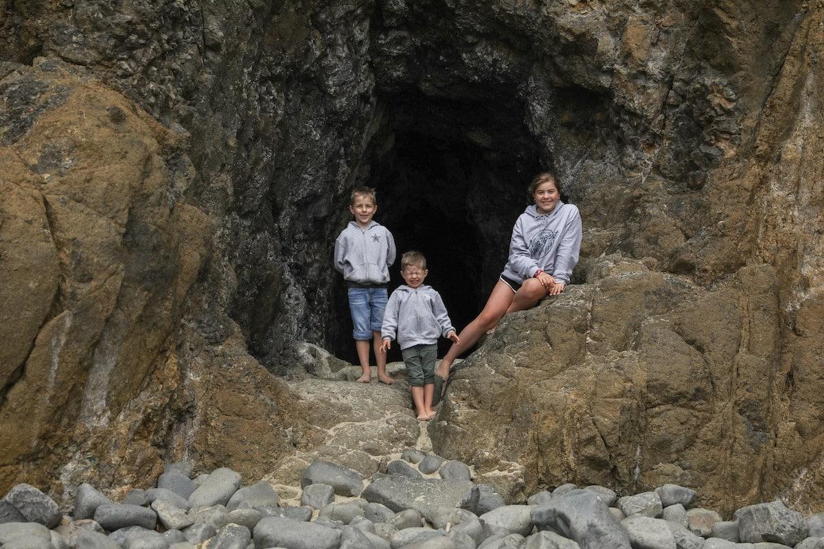 three kids posing on rocks