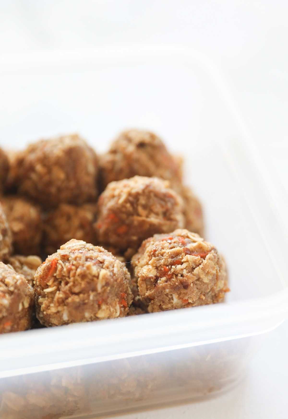 protein bites in tupperware container