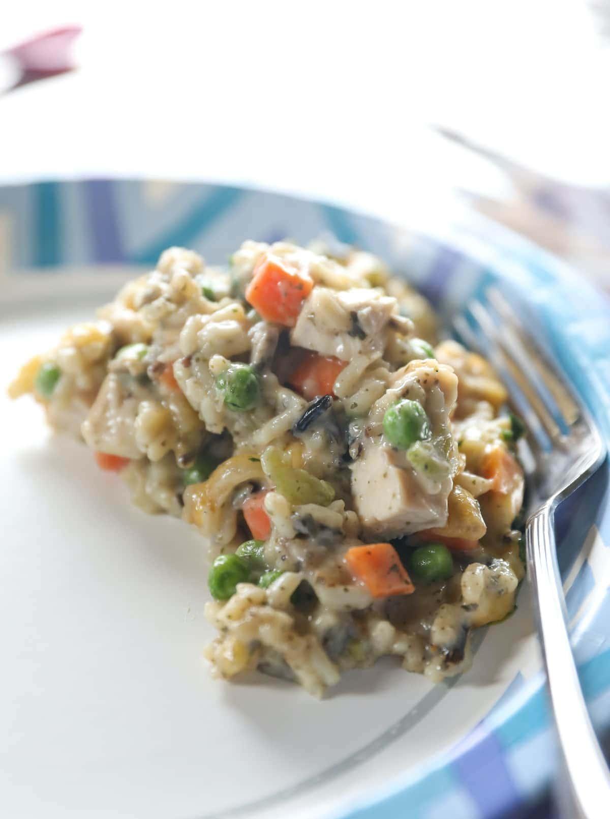 chicken wild rice casserole on blue plate
