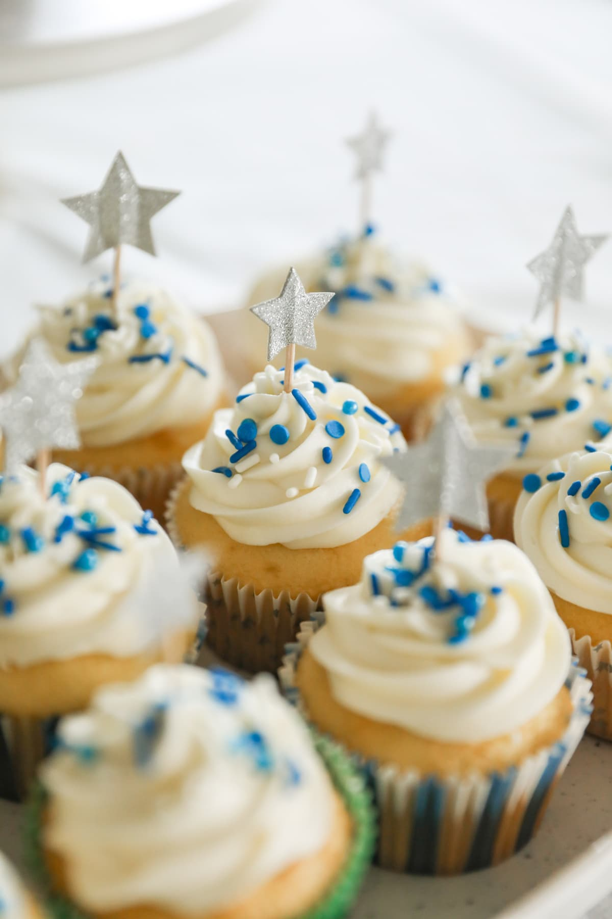 vanilla cupcakes with star decorations