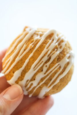hand holding pumpkin cookie