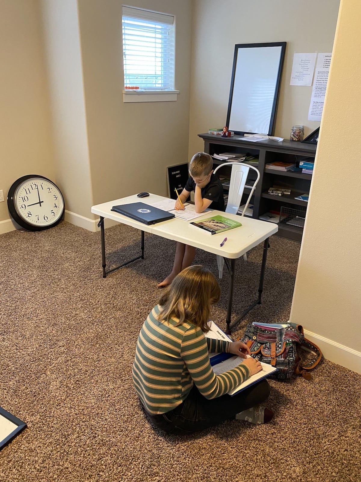 two kids doing homeschool