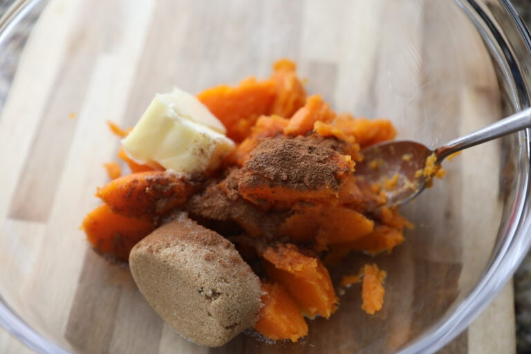 sweet potatoes with butter and sugar in glass bowl