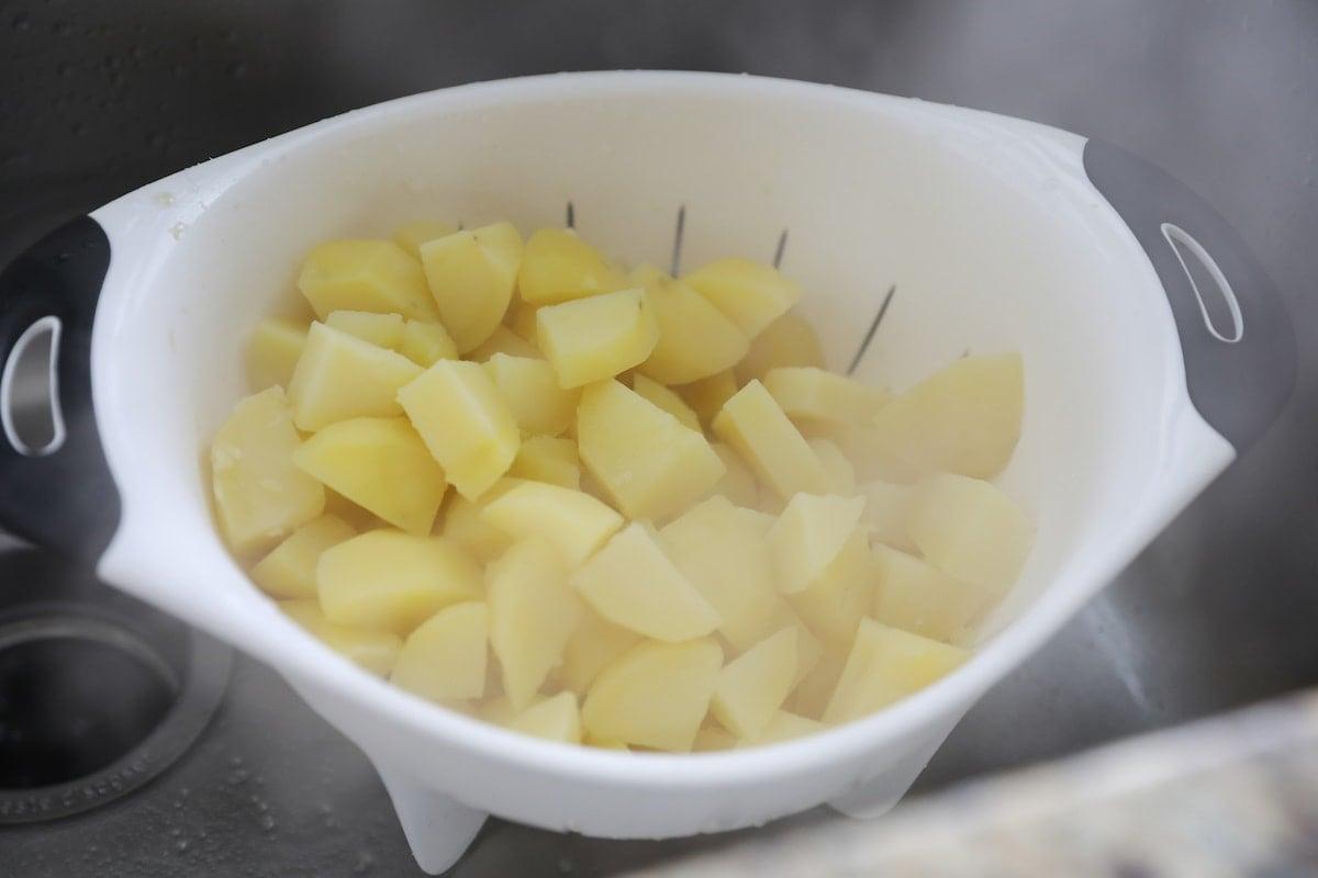 boiled potatoes in collander
