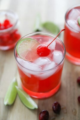 mocktail in glass with ice and cherry