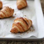 baked croissants on baking sheet