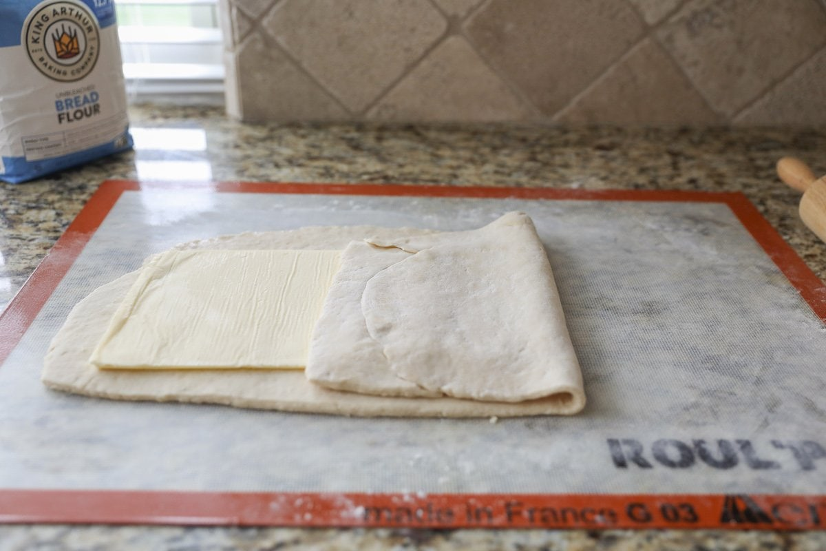 laminating croissant dough with butter