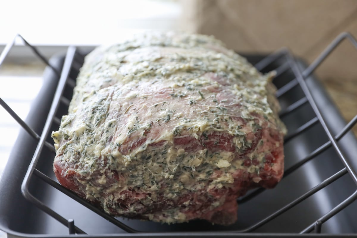 whole standing rib roast covered in herb butter