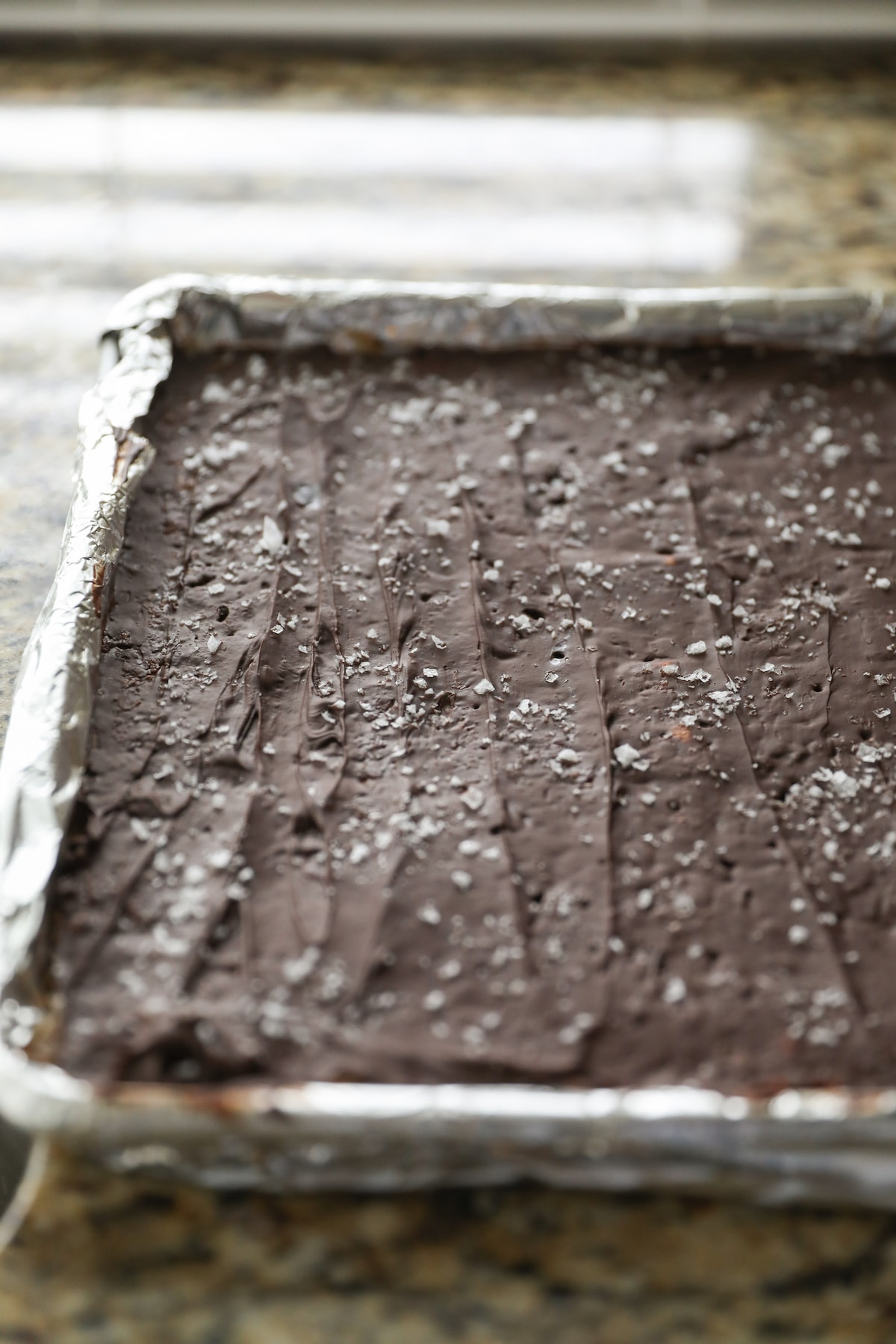 chilled christmas crack in baking sheet