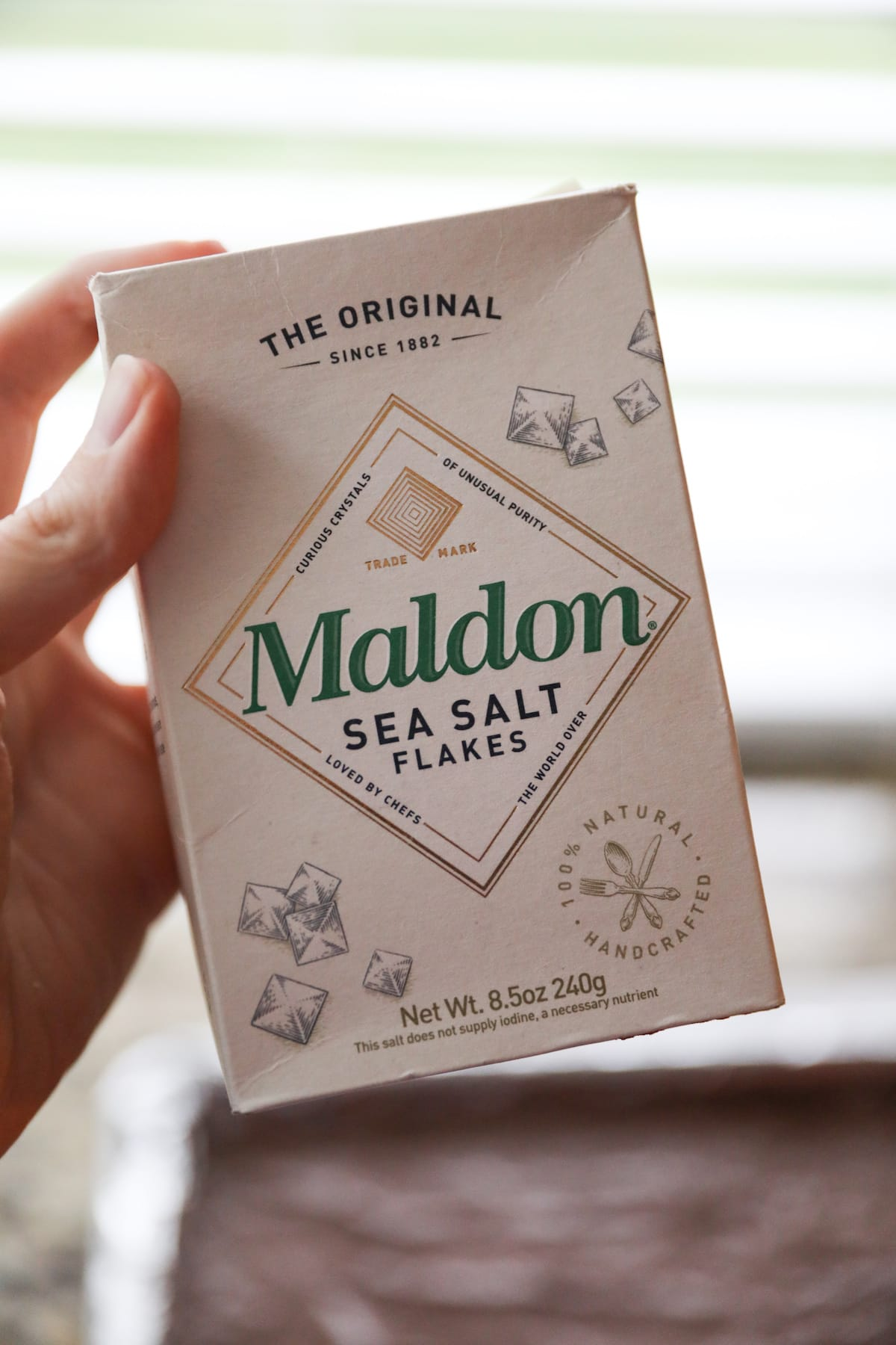 hand holding box of maldon sea salt