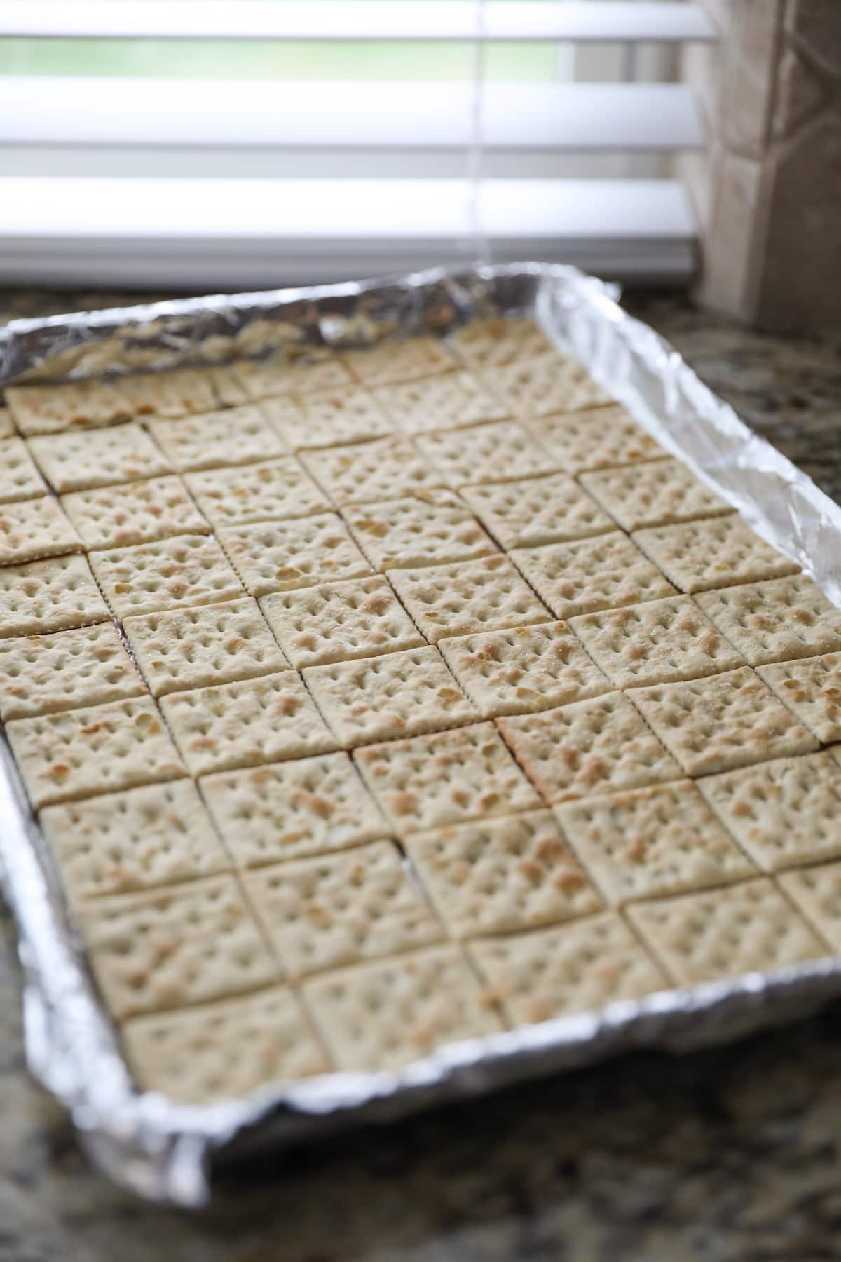 crackers lined on baking sheet