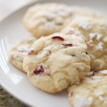 cranberry orange cookies on white plate