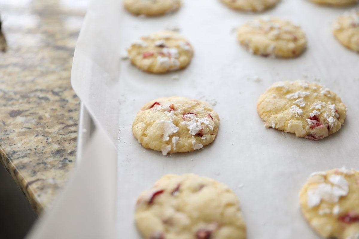 baked cranberry orange cookies on baking sheet