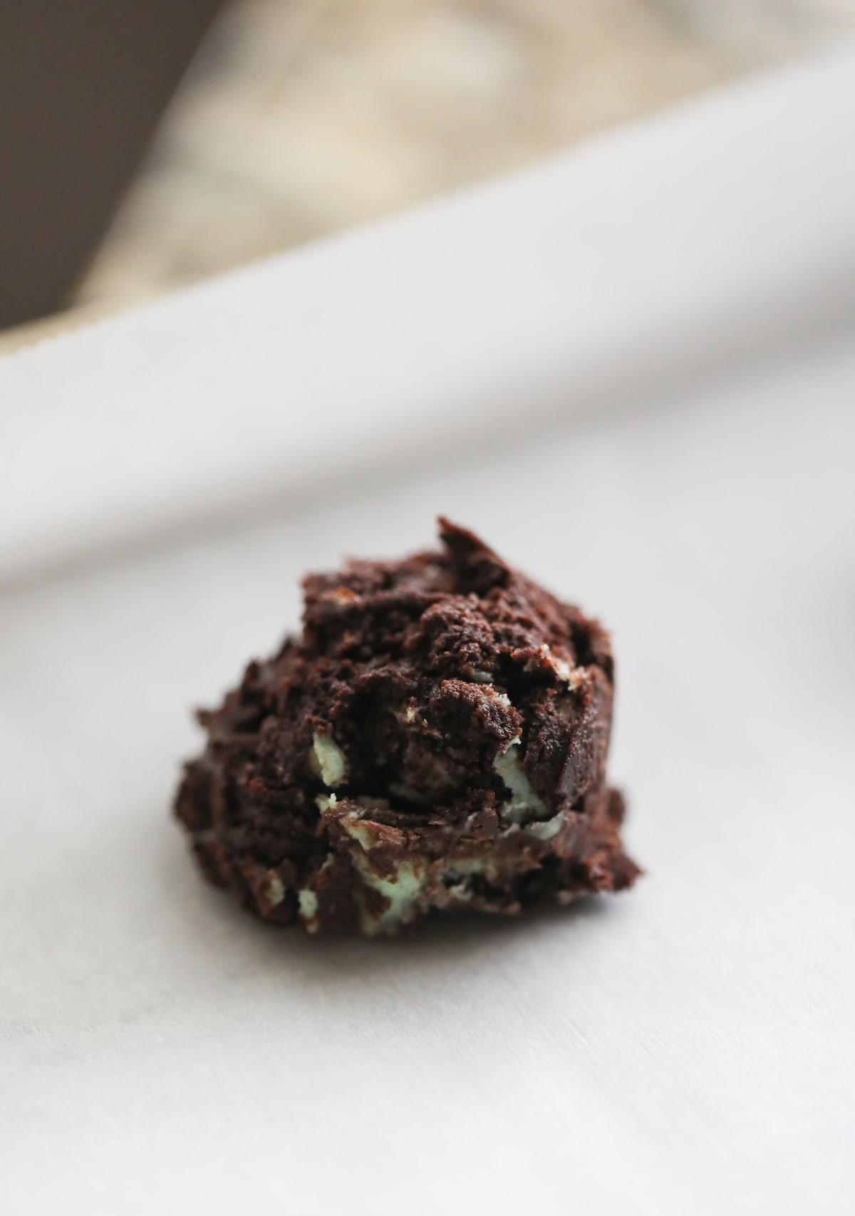 mint chocolate cookie dough scooped on baking sheets