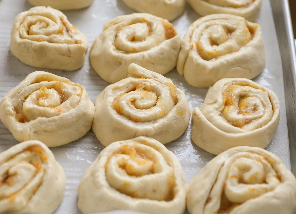 cut orange rolls in baking sheet