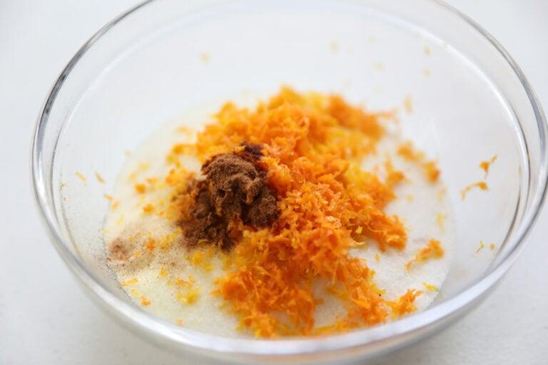 orange zest, cinnamon and sugar in glass bowl