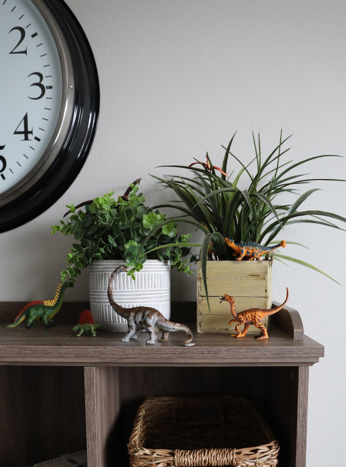 toy dinosaurs eating fake plants